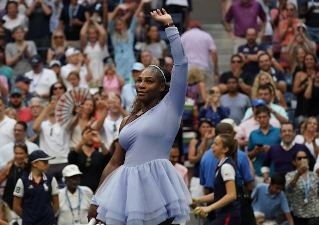 Milestone quest: Serena Williams celebrates her US Open fourth-round win over Kaia Kanepi on Sunday. (AFP Photo/TIMOTHY A. CLARY)