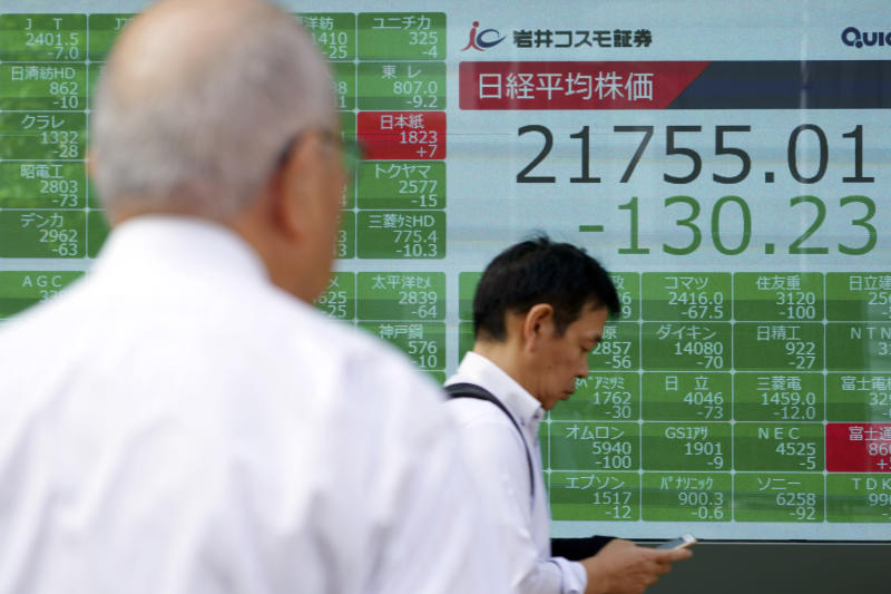 A man looks at an electronic stock board showing Japan's Nikkei 225 index at a securities firm in Tokyo Wednesday, Oct. 2, 2019. Asian shares are lower after U.S. stocks posted their worst loss in five weeks on Wednesday after a surprisingly limp report on the nation's manufacturing that stirred worries about the economic outlook.(AP Photo/Eugene Hoshiko)