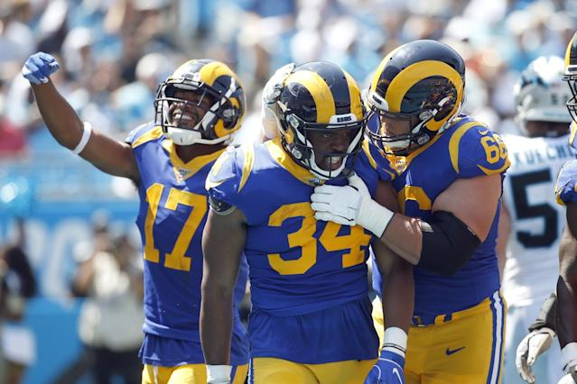 "Rams running back Malcolm Brown (34) is congratulated by center Austin Blythe (66) and receiver Robert Woods (17) after scoring a touchdown against the Panthers on Sept. 8. <span class=""copyright"">(Brian Blanco / Associated Press)</span>"
