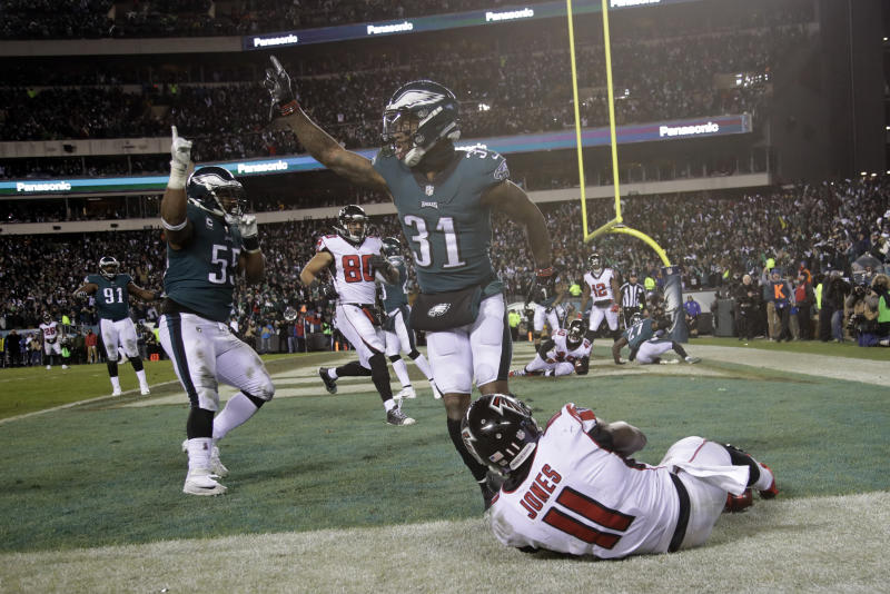 Jalen Mills (31) and Brandon Graham (55) celebrate after Julio Jones (11) cannot catch a fourth-down pass. (AP)