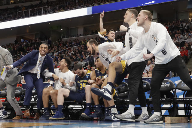UC Irvine players and coaches celebrate during the second half of a first round men's college basketball game against Kansas State in the NCAA Tournament, Friday, March 22, 2019, in San Jose, Calif. (AP Photo/Chris Carlson)