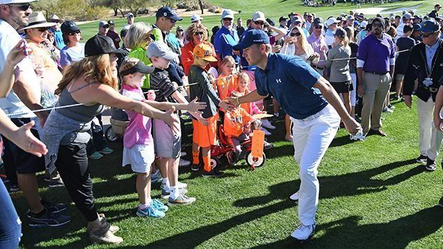 Jordan Spieth high-fives some excited kids. Pic: Getty
