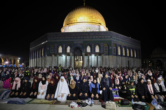 Palestinian Muslim worshippers pray during the Laylat al-Qadr, or the night of destiny, the holiest night of Ramadan, in front of the Dome of the Rock Mosque at the Al Aqsa Mosque compound May 8, 2021.