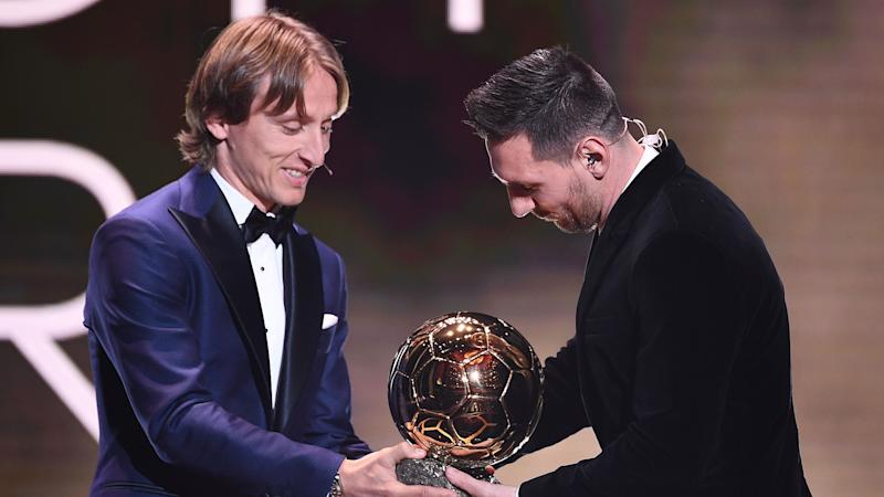 Real Madrid's Modric congratulates Barcelona rival Messi after sixth Ballon d'Or win
