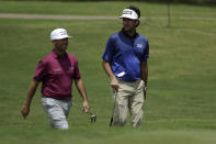 Chez Reavie, left, and Bubba Watson walk to the eighth green during the second round of the World Golf Championship-FedEx St. Jude Invitational Friday, July 31, 2020, in Memphis, Tenn. (AP Photo/Mark Humphrey)