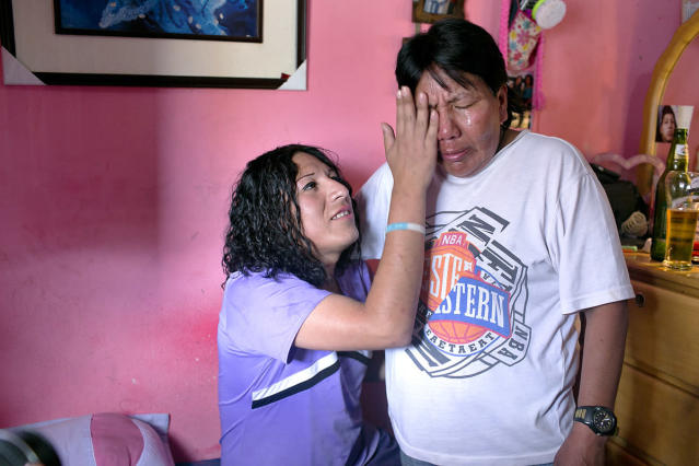 <p>Tamara comforts her mother, Evila, right, after a fight on Tamara's birthday in 2014. (Photo: Danielle Villasana) </p>
