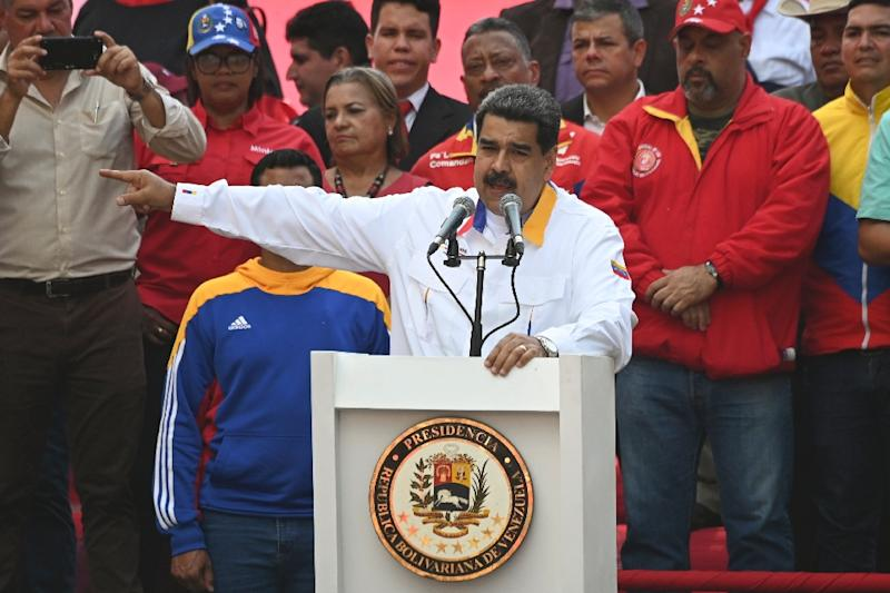 Venezuela's President Nicolas Maduro speaks during a rally in front of Miraflores Presidential Palace in Caracas on May 20, 2019. Embattled Venezuelan President Nicolas Maduro rallied hundreds of his supporters in Caracas on Monday to mark the anniversary of his controversial re-election in May 2018 polls widely denounced as rigged