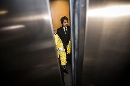 Jian Ghomeshi, a former celebrity radio host who has been charged with multiple counts of sexual assault, arrives at court as elevator doors close in Toronto January 8, 2015. REUTERS/Mark Blinch