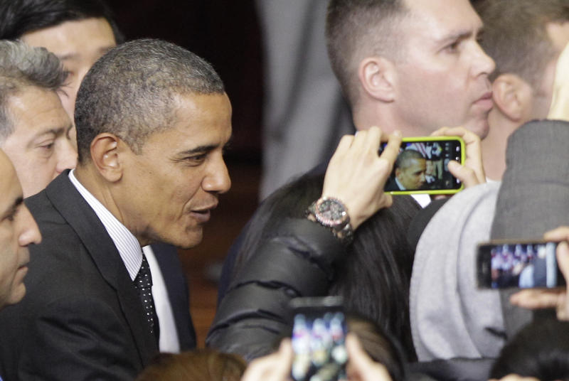 U.S. President Barack Obama, left, is taken photographs by students after delivering a speech at Hankuk University in Seoul, South Korea, Monday, March 26, 2012. (AP Photo/Lee Jin-man)