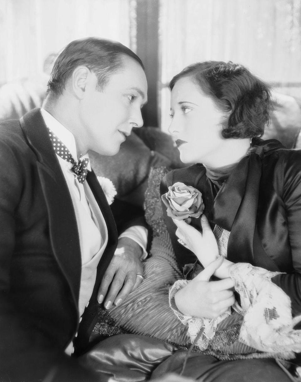 <p>In 1925, Joan was given a studio contract with MGM, took the stage name of Joan Crawford, and started appearing in silent films, such as <em>Lady of the Night</em> and <em>Paris. </em></p>