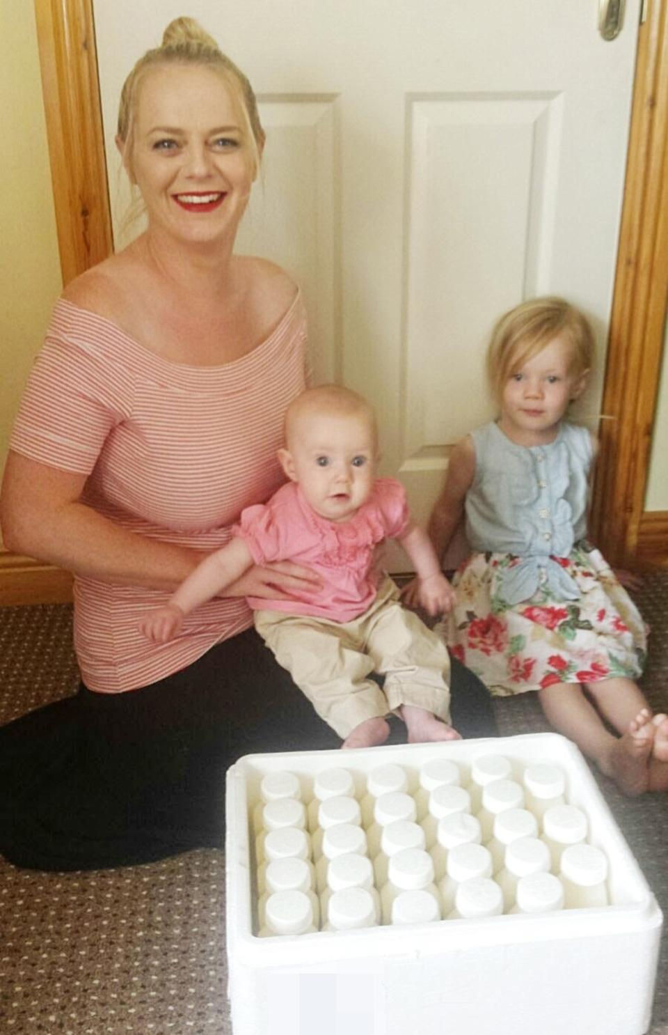 Natasha, pictured here with her daughters Grace and Ellie, and the milk she donated (PA Real Life/Collect)