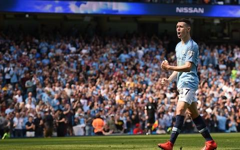 Manchester City's English midfielder Phil Foden celebrates scoring the opening goal during the English Premier League football match between Manchester City and Tottenham Hotspur at the Etihad Stadium - Credit: AFP
