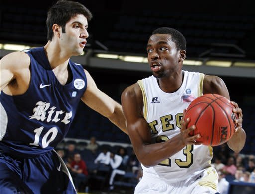 Rice guard Dan Peera (10) defends against Georgia Tech guard Brandon Reed (23) during the first half of their NCAA college basketball game in the first round of the DirecTV Classic in Anaheim, Calif., Thursday, Nov. 22, 2012. (AP Photo/Alex Gallardo)
