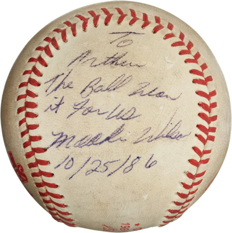 "This undated image, provided by Heritage Auctions, shows the ""Buckner Ball,"" the baseball that dribbled between the legs of Boston Red Sox first baseman Bill Buckner during the 10th inning of Game Six of the 1986 World Series. The error gave the New York Mets the win and the team went on to beat the Red Sox the next night to win the World Series. The writing, by Mookie Wilson addressed to Mets traveling secretary Arthur Richman says: To Arthur, the ball won it for us, Mookie Wilson, 10/25/86. Heritage Auctions says the ball is expected to bring in more than $100,000 on Friday, May 4, 2012,  in Dallas. (AP Photos/Heritage Auctions)"