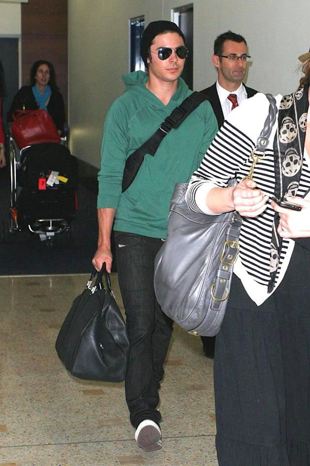 """Zac Efron's travel outfit consisted of a moss green sweatshirt and comfy jeans. Carlos Costas/<a href=""""http://www.pacificcoastnews.com/"""" target=""""new"""">PacificCoastNews.com</a> - March 11, 2009"""