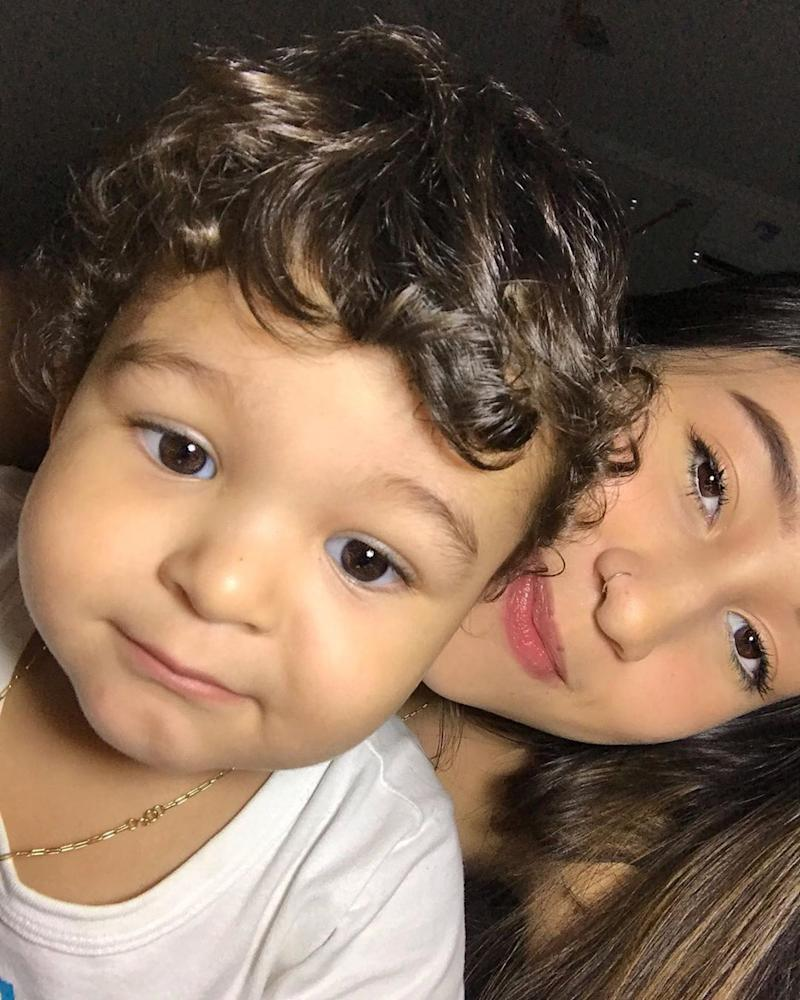 Pic shows: Aymee Almeida with her son. This young mother has revealed how she gave birth in her bathroom at home without knowing she was pregnant - cutting her own umbilical cord and disposing of the placenta using an Internet video.