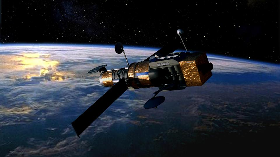 Military imaging reconnaissance satellite in Earth orbit. (ImageBank/Getty Images)