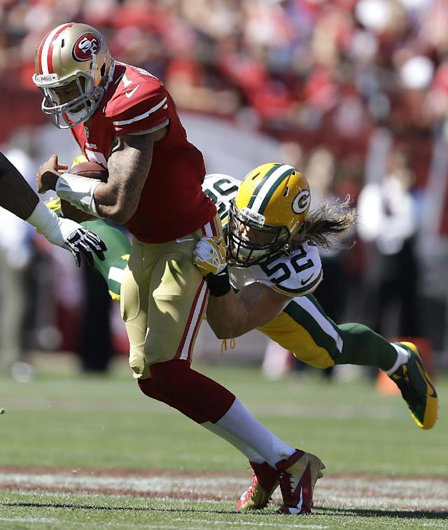 Green Bay Packers outside linebacker Clay Matthews (52) tackles San Francisco 49ers quarterback Colin Kaepernick (7) during the second quarter of an NFL football game in San Francisco, Sunday, Sept. 8, 2013. (AP Photo/Ben Margot)