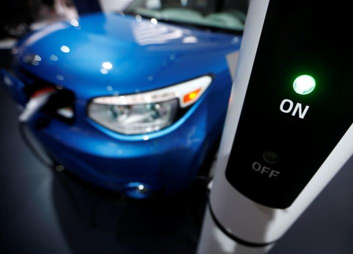 FILE PHOTO: A Kia Soul EV is plugged into a charging station during the second press day of the North American International Auto Show in Detroit