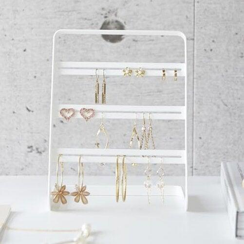 <p>The earring enthusiast will love having this sleek <span>Tower Earring Stand</span> ($22) to hold their things.</p>