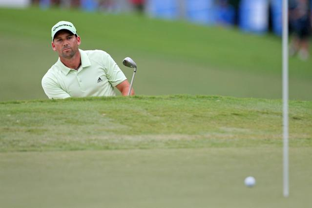 GREENSBORO, NC - AUGUST 18: Sergio Garcia of Spain watches his third shot on the 15th hole during the third round of the Wyndham Championship at Sedgefield Country Club on August 18, 2012 in Greensboro, North Carolina. (Photo by Hunter Martin/Getty Images)