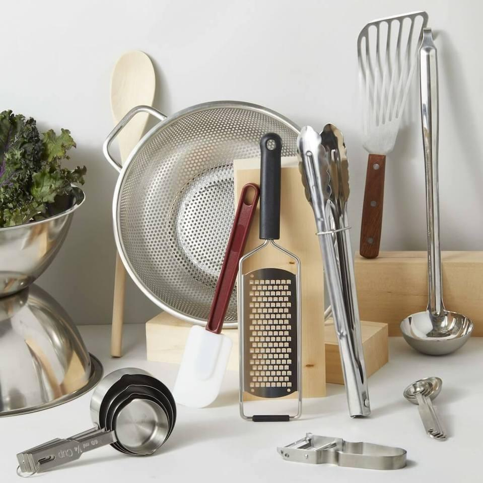 """<h2>Utensils Set</h2><br>A simple and essential bundle of cooking utensils; from mixing bowls and spatulas to measuring cups and peelers. <br><br><strong>Goldilocks</strong> Utensil Set, $, available at <a href=""""https://go.skimresources.com/?id=30283X879131&url=https%3A%2F%2Fcookgoldilocks.com%2Fproducts%2Futensil-set"""" rel=""""nofollow noopener"""" target=""""_blank"""" data-ylk=""""slk:Goldilocks"""" class=""""link rapid-noclick-resp"""">Goldilocks</a>"""