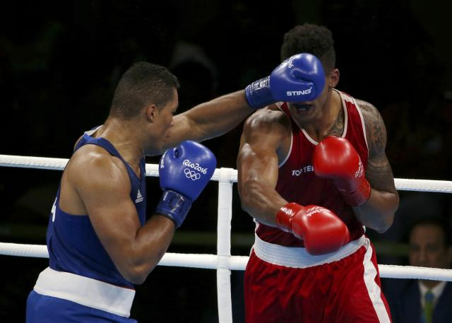 2016 Rio Olympics - Boxing - Final - Men's Super Heavy (+91kg) Final Bout 273 - Riocentro - Pavilion 6 - Rio de Janeiro, Brazil - 21/08/2016. Tony Yoka (FRA) of France and Joseph Joyce (GBR) of Britain compete. REUTERS/Matthew ChildsFOR EDITORIAL USE ONLY. NOT FOR SALE FOR MARKETING OR ADVERTISING CAMPAIGNS.