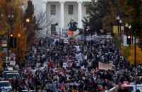 People gather in front of the White House after news media declared Democratic U.S. presidential nominee Joe Biden to be the winner of the 2020 U.S. presidential election, in Washington