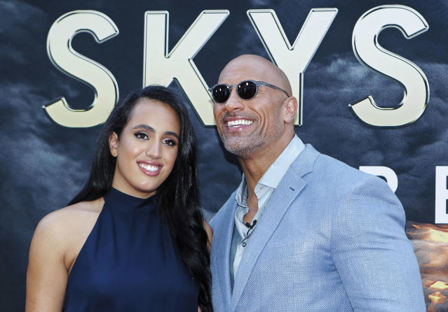Actor Dwayne Johnson and his daughter Simone Alexandra Johnson attend the premiere of 'Skyscraper' on July 10, 2018 in New York City. (Photo by KENA BETANCUR / AFP) (Photo credit should read KENA BETANCUR/AFP via Getty Images)