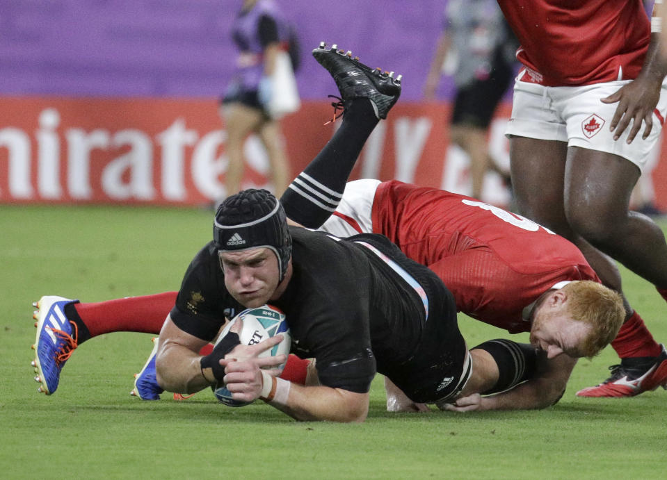 New Zealand's Matt Todd is tackled during the Rugby World Cup Pool B game at Oita Stadium between New Zealand and Canada in Oita, Japan, Wednesday, Oct. 2, 2019. The All Blacks defeated Canada 63-0. (AP Photo/Aaron Favila)