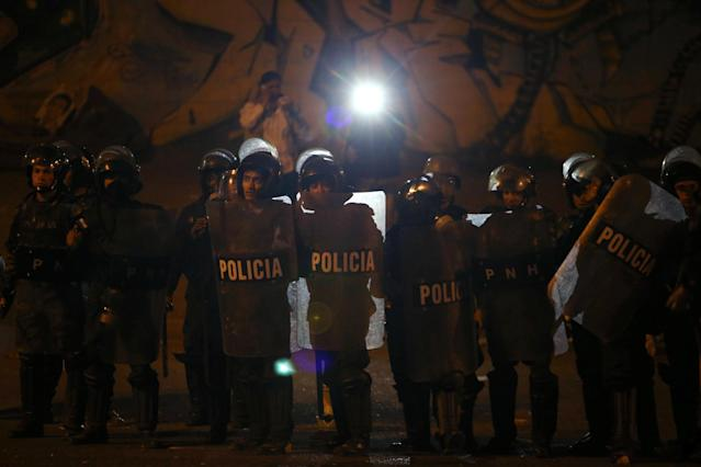 <p>Riot police are pictured during a protest of supporters of Salvador Nasralla, presidential candidate for the Opposition Alliance Against the Dictatorship, while waiting for the official presidential election results outside the warehouse of the Supreme Electoral Tribunal in Tegucigalpa, Honduras, Nov. 30, 2017. (Photo: Edgard Garrido/Reuters) </p>