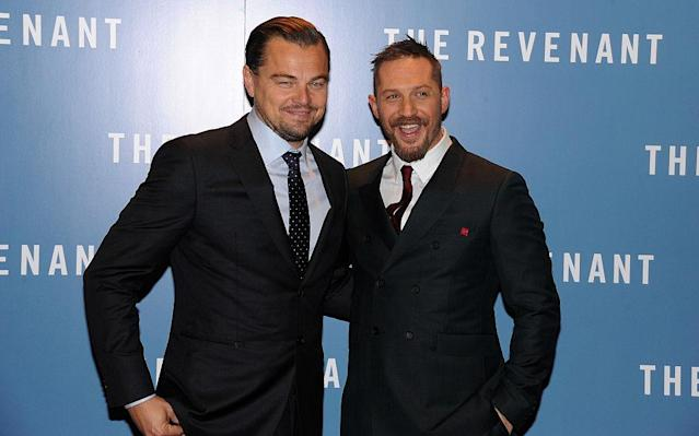 Tom Hardy and Leonardo DiCaprio attend the U.K. premiere of <em>The Revenant</em> in London in 2016. (Photo: Dave J. Hogan/Getty Images)