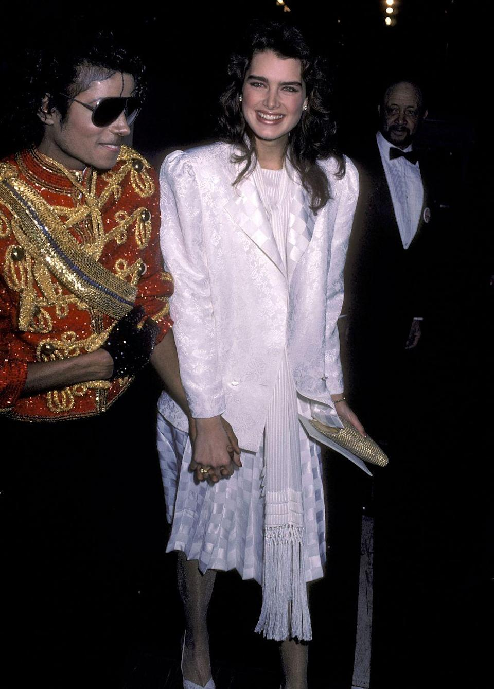 """<p>Here, Brooke is pictured at the 11th annual American Music Awards with Michael Jackson. Brooke and Michael were very good friends, and in 2009, she told <em><a href=""""https://www.rollingstone.com/music/music-news/brooke-shields-recalls-special-relationship-with-michael-jackson-104525/"""" rel=""""nofollow noopener"""" target=""""_blank"""" data-ylk=""""slk:Rolling Stone"""" class=""""link rapid-noclick-resp"""">Rolling Stone</a></em> that although he asked her to marry him several times, they had a strictly platonic relationship. """"You saw women who were more sexual, who wanted to throw themselves at him and feel like they were going to teach him. We just found each other, and we didn't have to deal with our sexuality,"""" she said. </p>"""