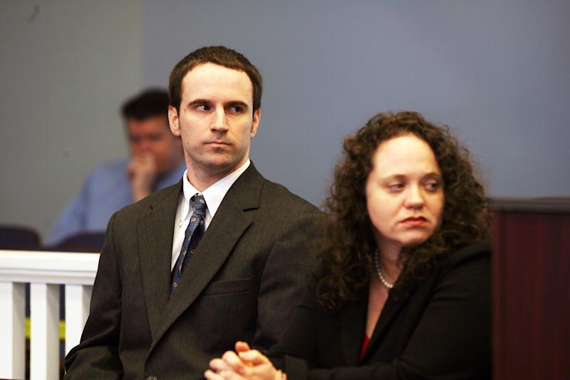 U.S. Army Pvt. Christopher Salmon, left, accompanied by his attorney, Gabrielle Amber Pittman, listens during a hearing Thursday, April 3, 2014, in a Long County, Ga. courtroom. Salmon pleaded guilty to malice murder charges in the killing of former military colleague Michael Roark, and was sentenced to life in prison with no chance of parole. (AP Photo/Lewis Levine)