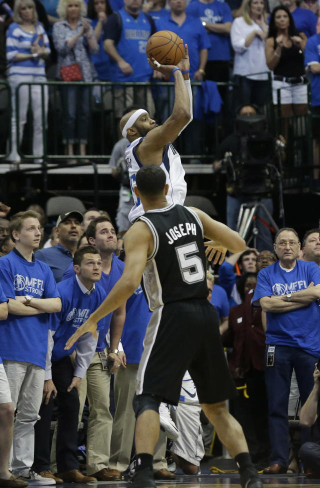 Dallas Mavericks guard Vince Carter, top, shoots the game-winning 3-point basket at the buzzer over San Antonio Spurs guard Cory Joseph (5) in the fourth quarter of Game 3 in the first round of the NBA basketball playoffsin Dallas, Saturday, April 26, 2014. The Mavericks won 109-108. (AP Photo/LM Otero)
