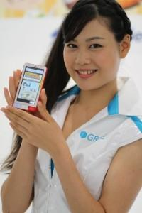 GREE model poses with Android Infobar phone, Tokyo Game Show 2011