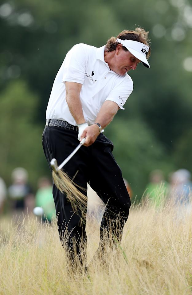 JERSEY CITY, NJ - AUGUST 23: Phil Mickelson of the United States hits his second shot on the 15th hole during a continuation of the first round on the second day of The Barclays at Liberty National Golf Club on August 23, 2013 in Jersey City, New Jersey. (Photo by Jeff Gross/Getty Images)