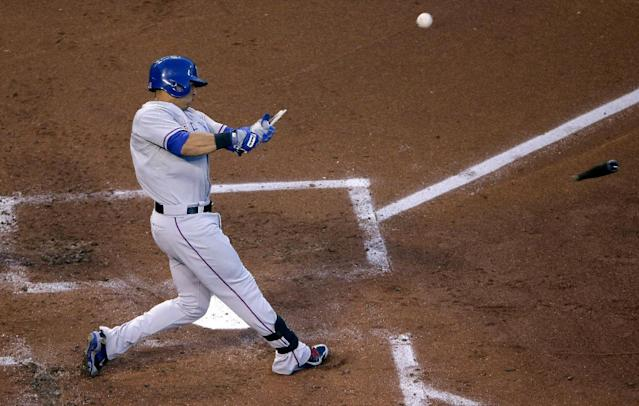 Texas Rangers' Leonys Martin breaks his bat as he pops out during the second inning of a baseball game against the Kansas City Royals, Wednesday, Sept. 3, 2014, in Kansas City, Mo. (AP Photo/Charlie Riedel)