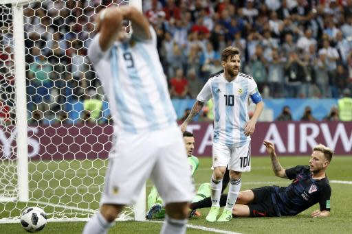 Argentina's Lionel Messi, center, reacts after missing to score during the group D match between Argentina and Croatia at the 2018 soccer World Cup in Nizhny Novgorod Stadium in Nizhny Novgorod, Russia, Thursday, June 21, 2018. (AP Photo/Petr David Josek)