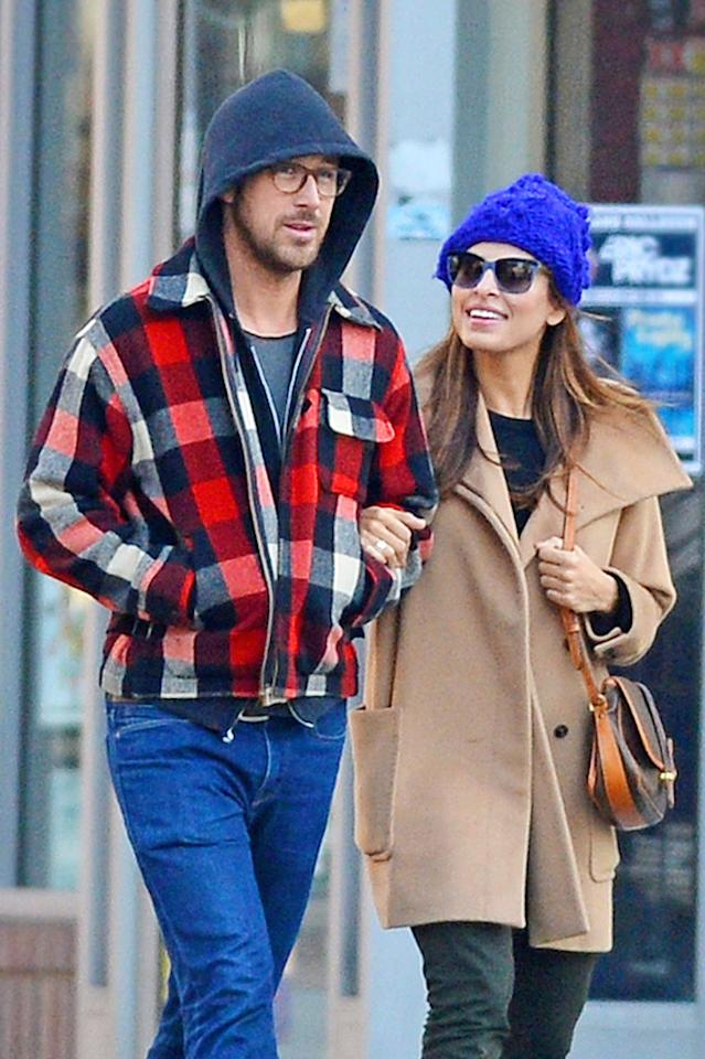 **EXCLUSIVE** Ryan Gosling and Eva Mendes bundle up and go arm in arm for a Thanksgiving morning stroll around New York City