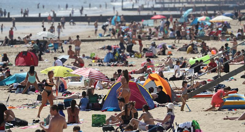 Beachgoers were shown not adhering to social distancing rules. Source: AAP