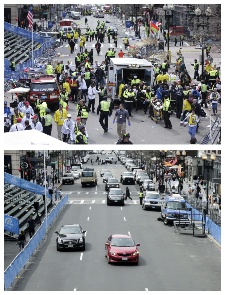 This combination of April 15, 2013 and April 14, 2014 photos shows medical workers aiding injured people on Boylston Street near the finish line of the 2013 Boston Marathon following two bomb explosions, and nearly a year later traffic flowing on the same street as preparations are being made for the 2014 Boston Marathon in Boston. (AP Photo/Charles Krupa, File)
