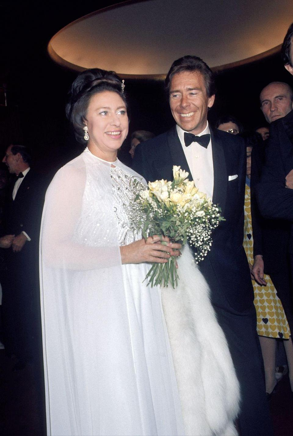 <p>Princess Margaret wore a white caped gown with sequined detailing to a ballet performance she attended with her husband, Antony Armstrong-Jones, in New York. </p>