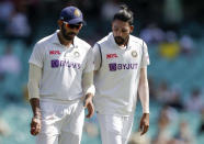 Indian bowler Jasprit Bumrah, left, and Mohammed Siraj talk during play on day one of the third cricket test between India and Australia at the Sydney Cricket Ground, Sydney, Australia, Thursday, Jan. 7, 2021. (AP Photo/Rick Rycroft)