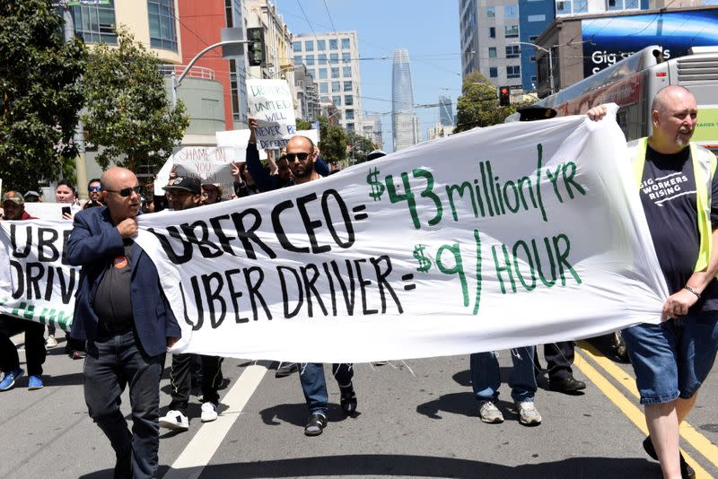 FILE PHOTO: Protestors march through the financial district, demanding fair wages and more transparency during a strike against Uber in San Francisco