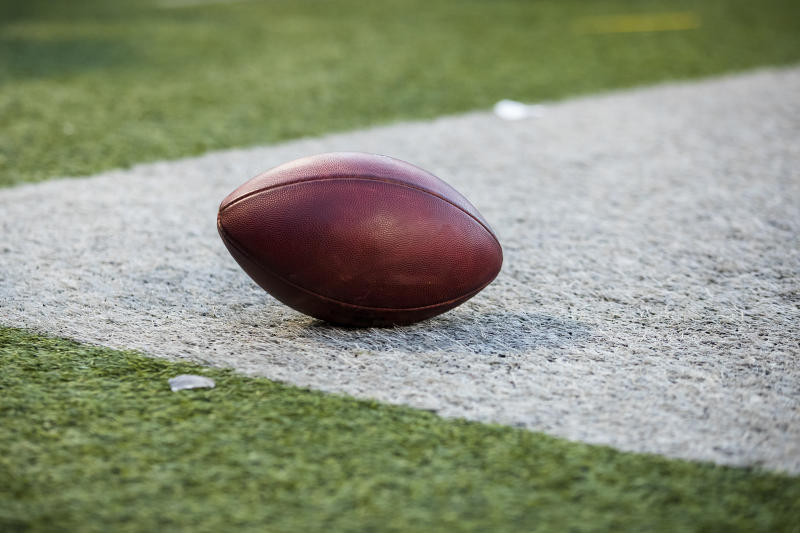 A player reportedly whipped off his helmet and charged at an official during a season opener in Ohio on Saturday after a flag was thrown on the play.