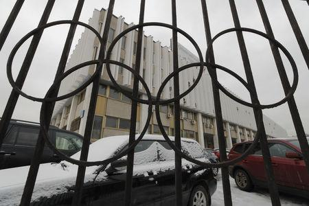 A view through a fence shows the Russian Olympic Committee headquarters in Moscow, Russia December 5, 2017. REUTERS/Maxim Shemetov