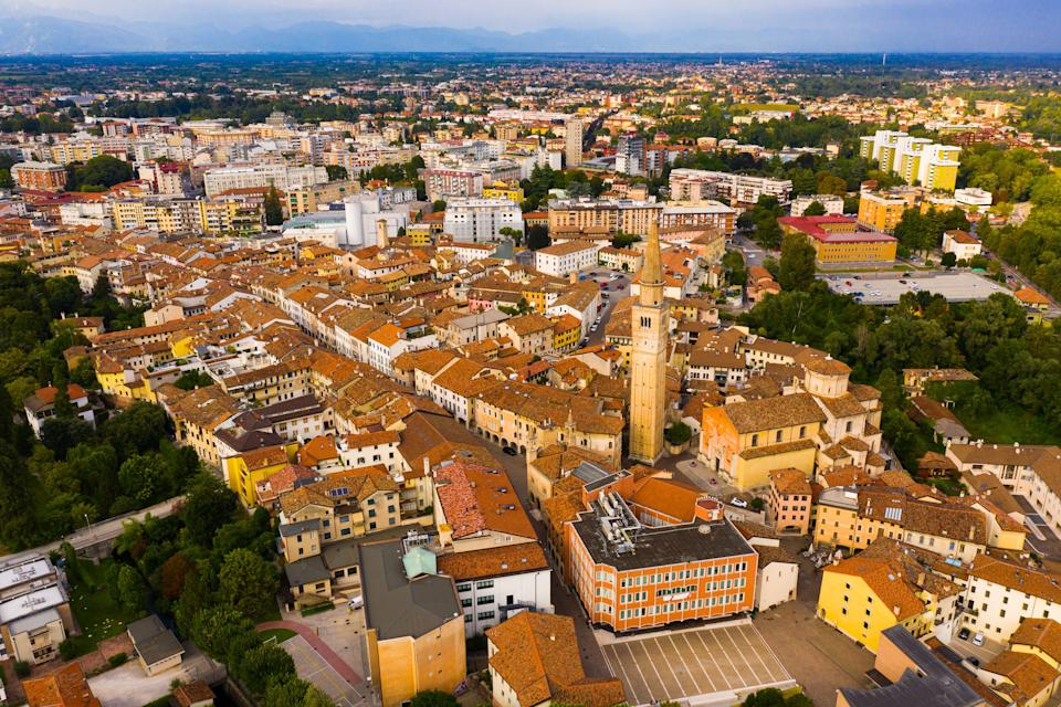 Scenic cityscape from drone of Italian town of Pordenone in sunny day, Italy (Photo: JackF via Getty Images)