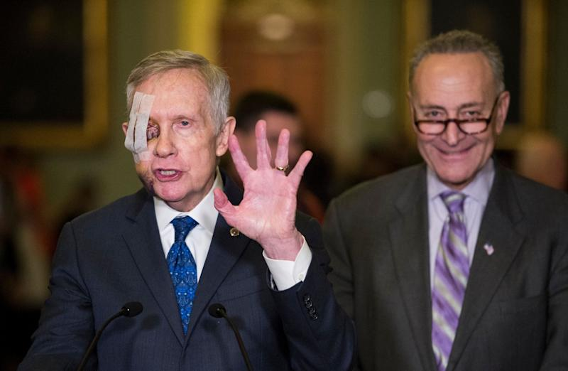 Senate Minority Leader Harry Reid (D-Nev.) speaks to the media as Sen. Chuck Schumer (D-N.Y.) listens, following the Senate Democrats' policy lunch on Feb. 3, 2015.