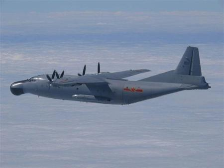 A Chinese military plane Y-8 airborne early warning plane flies through airspace between Okinawa prefecture's main island and the smaller Miyako island in southern Japan